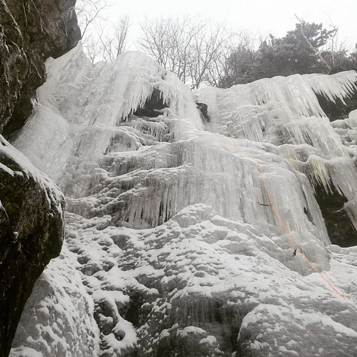 Ice climbing Dracula at Frankenstein Cliffs in Crawford Notch, New Hampshire.